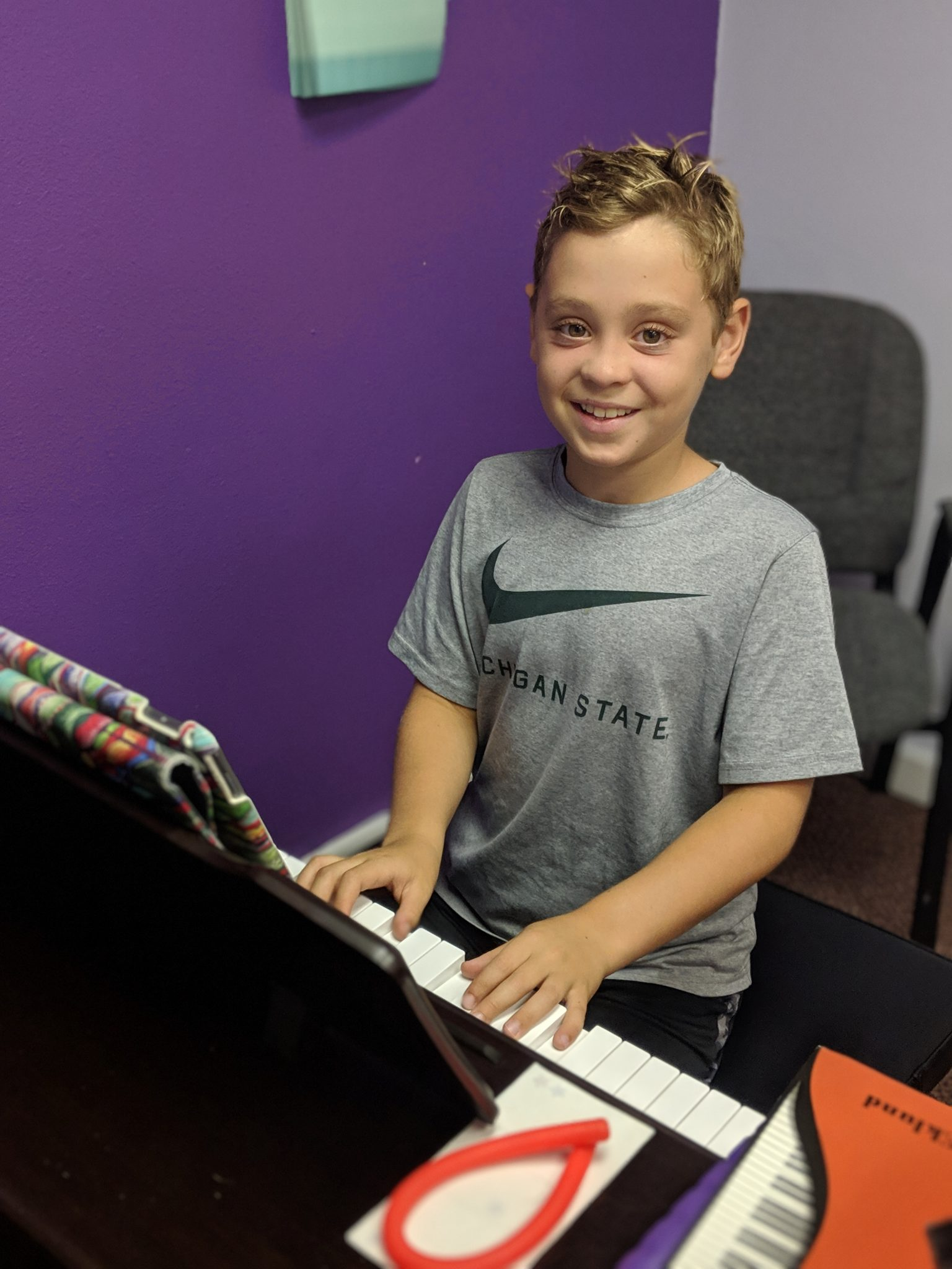 Happy boy piano student